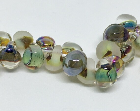 Southern Marsh Unicorne Beads Boro Teardrops, 25 Beads Per Strand, Mixed Greens Tumbled And Metallic Color On Each Strand