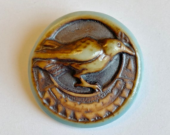 Raven Porcelain Round Pendant, High Fired Porcelain Pendant Design with Turquoise Glaze Rim over an Iron Wash