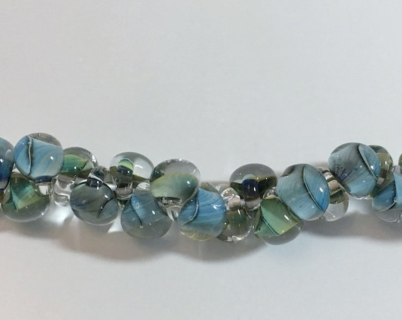 Multi Forest Unicorne Beads Boro Teardrops, 25 Beads Per Strand, Mixed Blues And Greens On Each Bead