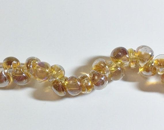 Electric Dandelion Unicorne Beads Boro Teardrops, 25 Beads Per Strand, Golden Shades of Yellow On Each Bead