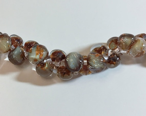 Midnight Spell Unicorne Beads Boro Teardrops, 25 Beads Per Strand, Mixed Browns And Beige Colors On Each Strand