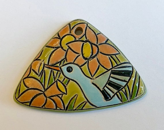 Hummingbird Pendant, A Triangle Shaped Stoneware Pendant, Hand Carved And Hand Painted, Glazed On Both Sides