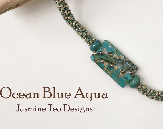 Ocean Blue Aqua Beaded Kumihimo Necklace, Asymmetric Necklace with Artisan Lamp Worked Focal Bead