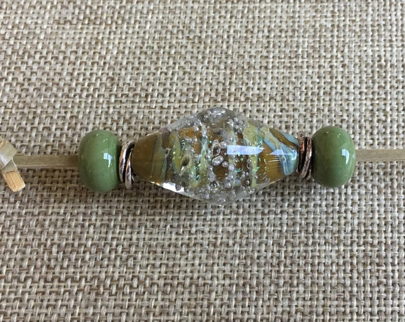 Sage Lampwork Bicone With Silver Starbursts Focal Bead, Lampwork Moss Spacers And Tierra Cast Silver Swirls Spacers, Five Piece Set