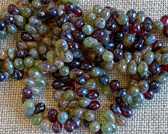 7x5mm A Mix of Red, Transparent Peridot, and Green Apple, Picasso Finish, 7x5mm Teardrop Beads, 50 Teardrops Per Strand