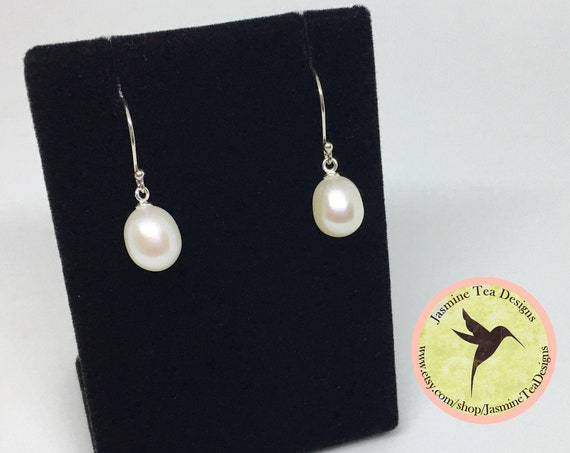 White Fresh Water Pearl Drop Earrings In Sterling Silver, Pearls Are AAA Quality And Measure 15x10mm, Sterling Silver French Earring Hooks