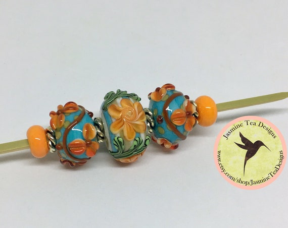 South Beach Rondelle Beads With Orange Flowers, Green Leaves, Raised Floral Design And Turquoise, 9 Piece Set