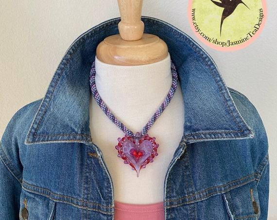 "Pink, Purple and Red Beaded Kumihimo Necklace Featuring Stephanie Sersich's Artisan Lampwork Heart, 17"" Necklace with 2"" Extender"