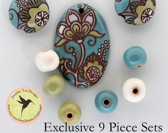 Cotton Flower Oval Pendant In Blues And Greens With Lentils And Coordinating Rounds, 9 Piece Set Exclusive For Jasmine Tea Designs by Golem
