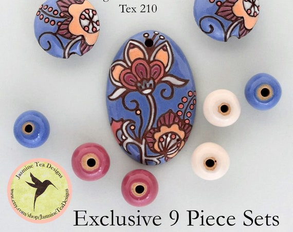 Cotton Flower Oval Pendant In Blue And Coral With Lentils And Coordinating Rounds, 9 Piece Set Exclusive For Jasmine Tea Designs by Golem