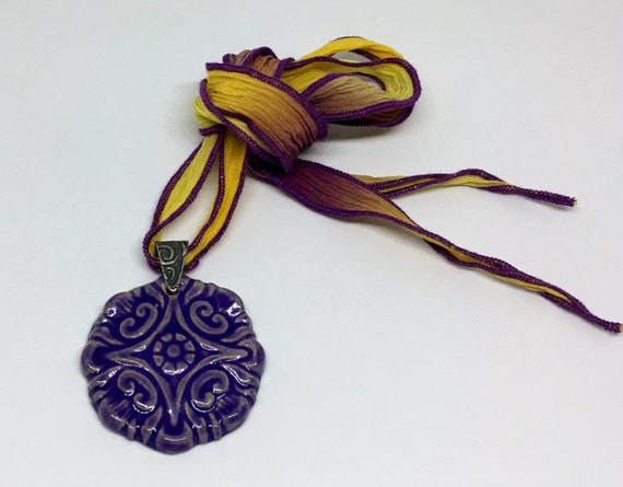 Purple Compass Flower Pendant Necklace With Hand Dyed Silk Ribbon And Antique Silver Bail, Untied Measures 19 Inches