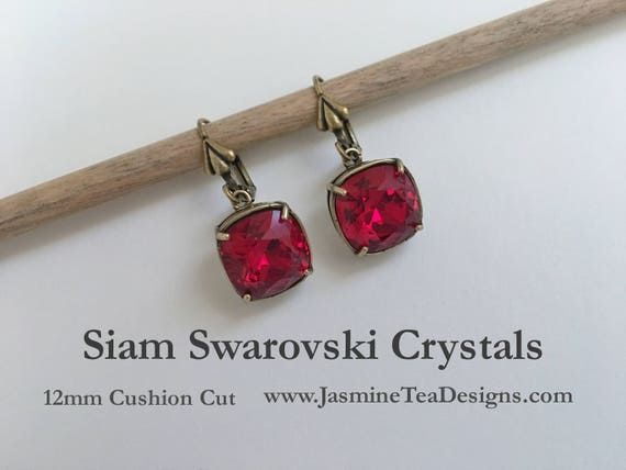 Siam Swarovski Earrings, 12mm Cushion Cut Crystals, Set In Vintage Patina Antique Gold Tone, Fleur de Lis Motif Lever Back Ear Wires