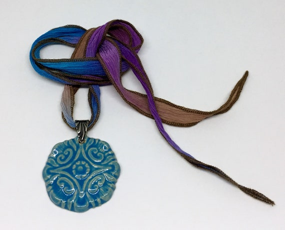 Blue Compass Flower Pendant Necklace With Blended Hand Dyed Silk Ribbon And Antique Silver Bail, Untied Measures 19 Inches