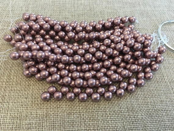 Saturated Metallic Pale Dogwood, 6mm Top Hole Round Beads, Color Trends, 25 Beads Per Strand