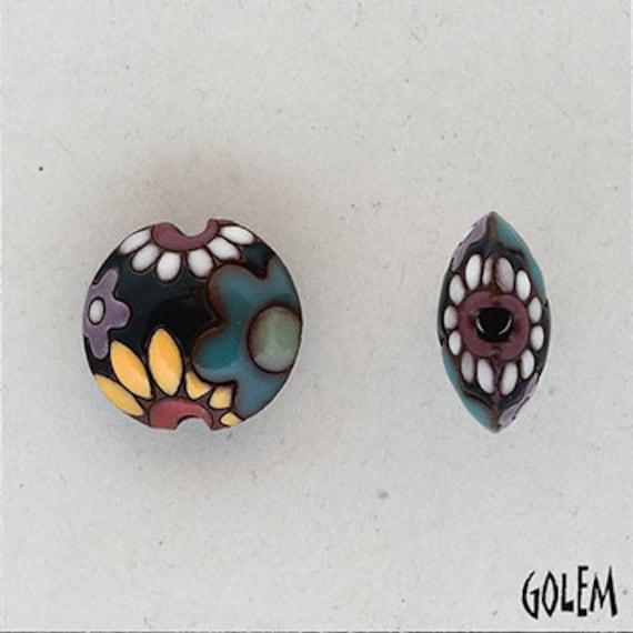 Multi Colored Flowers On Dark Blue, Ceramic Lentil Bead, Small Hand Carved Lentil Bead, Golem Design Studio Beads
