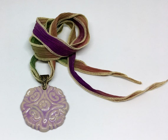 Lavender Compass Flower Pendant Necklace With Hand Dyed Silk Ribbon And Antique Brass Bail, Untied Measures 19 Inches