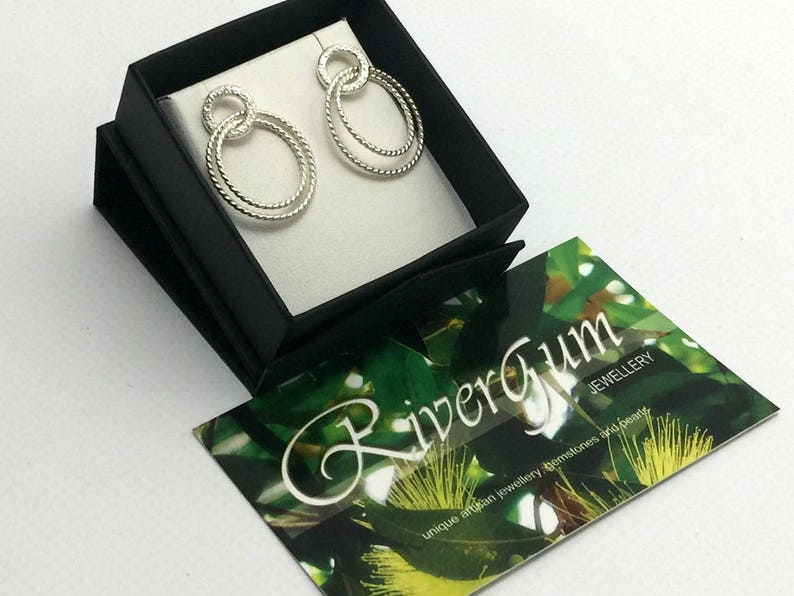 Handmade by Rivergum Jewellery on Etsy Sterling Silver Circle Stud Earrings with Swinging Twisted Hoops Hammered Finish