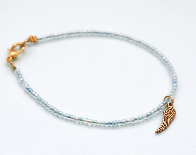 Customizable thin seed bead bracelet any colour with gold wing charm.