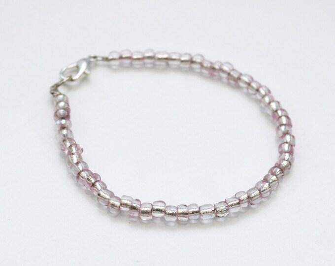 Clear seed bead bracelet.