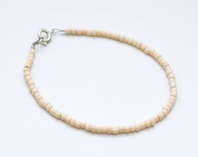 Peach seed bead bracelet.