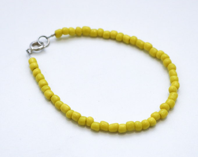 Yellow Skinny Beaded Bracelet in gold or silver.
