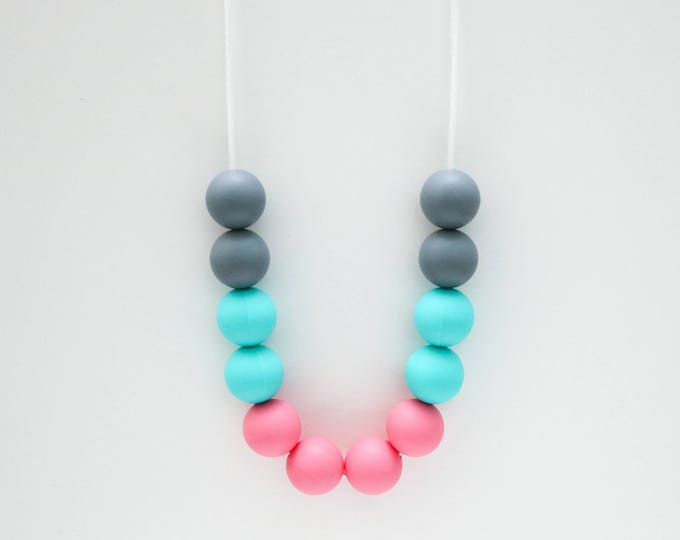 Santa Barbara Silicone Beaded Sensory Pink, Blue and Grey Necklace.