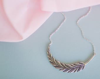 Silver Feather Charm Statement Necklace.