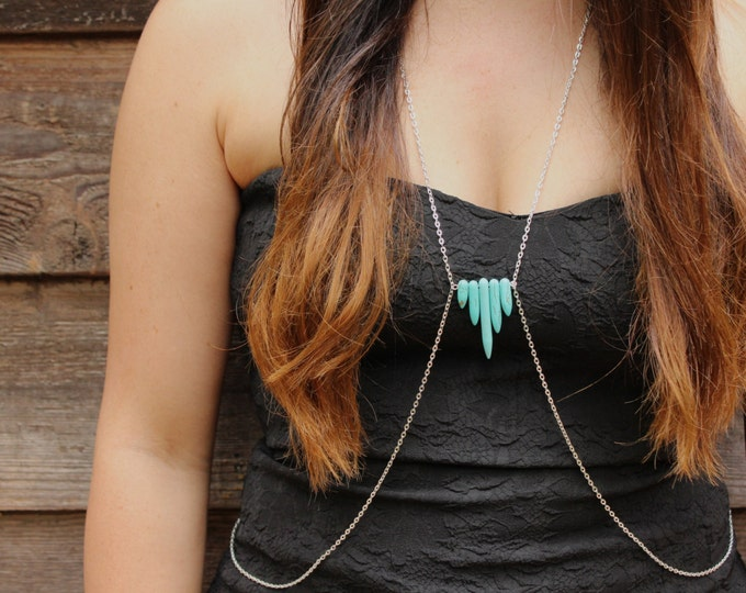 Turquoise body chain.