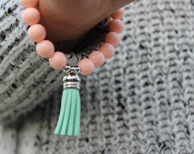 Pastel Pink and Turquoise beaded tassel bracelet.