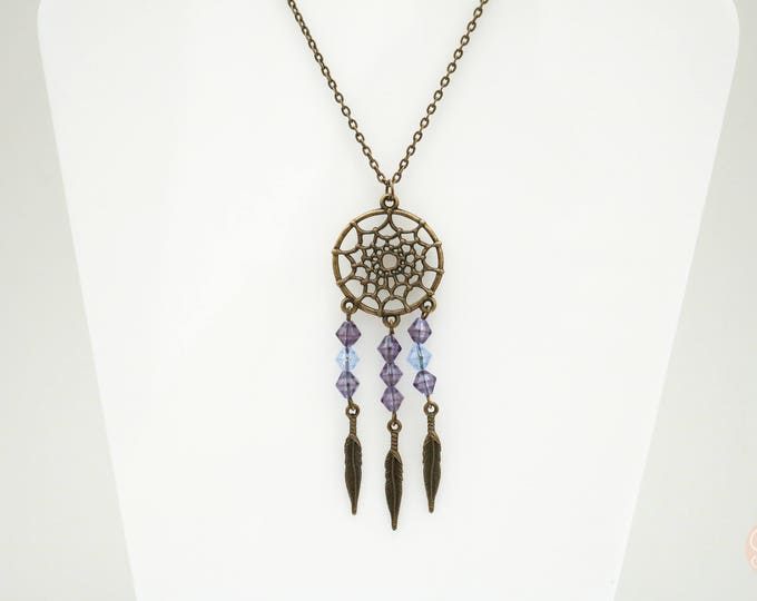 Purple and antiqued bronze dream catcher necklace.