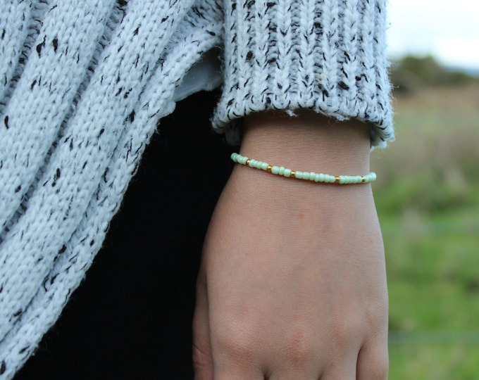 Mint seed bead bracelet with gold speckles.