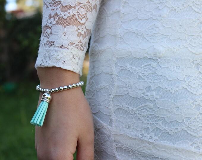 Turquoise and Silver Beaded Tassel Bracelet.
