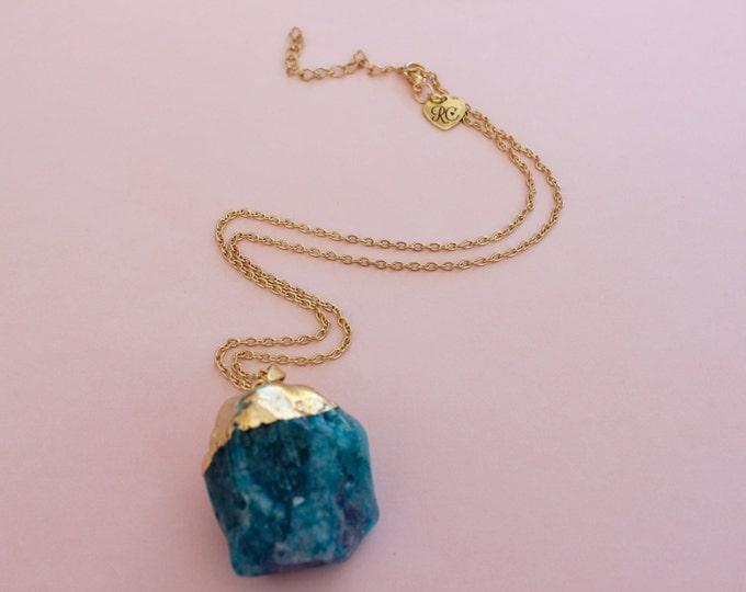 Blue quartz crystal necklace.
