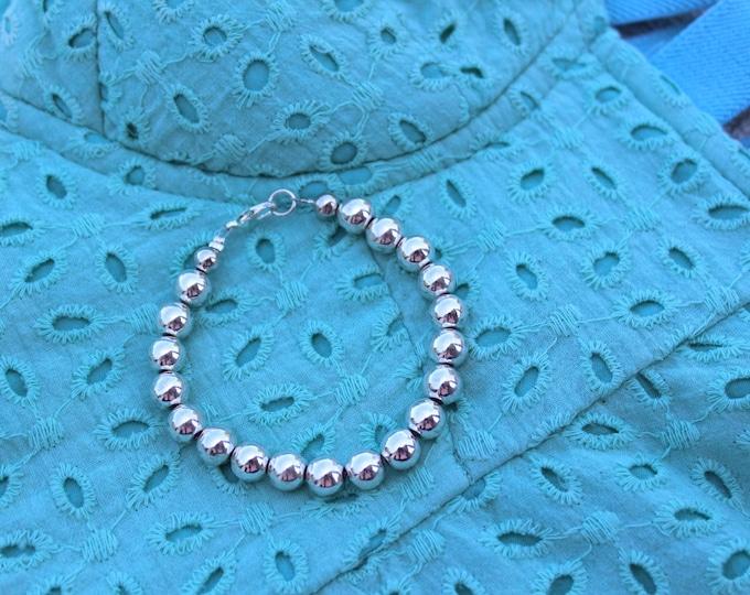 Silver Beaded Bracelet.
