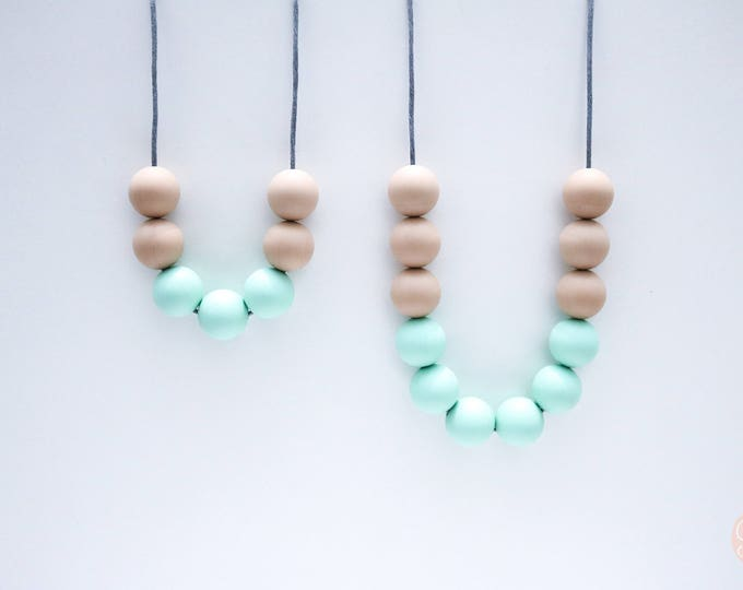 Copa Mum and Bub set Tan and Mint Silicone Sensory Necklaces.