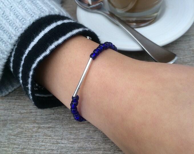 Navy Blue Beaded Seed Bracelet with Grey Silk Tassel.