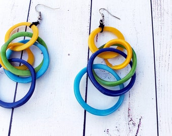 "Long hoops  tagua  earrings 4"" long hits over shoulder contrasting colors"