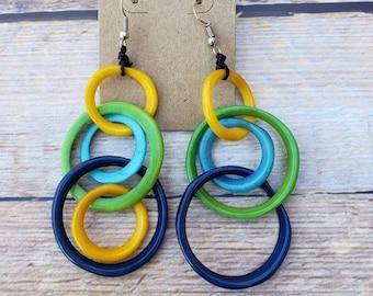 "Long hoops  tagua  earrings 4"" long hits over shoulder contrasting colors"