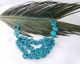 Tagua chain rings asymmetrical layered necklace 80s inspired for Tiki Oasis