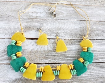 Triangles tagua geometric necklace yellow and teal by  Allie