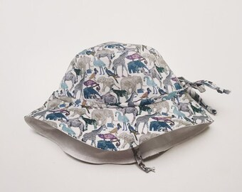 BONNY BRIMMED HAT constructed from Liberty Art fabric Queue For The Zoo (blue) lined in Natural or White Linen