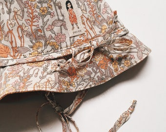 BONNY BRIMMED HAT constructed from Liberty Art fabric Flowers B (yellow) lined in Mustard or White Linen