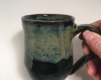 Black with citrus glaze mug cup hand made by Ruth Sachs to add to your collection or give to a friend. Always a good gift.