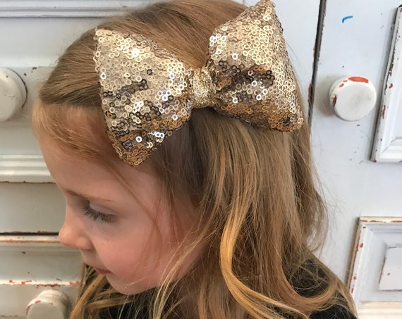 gold bow , gold hairbow , sparkle bow