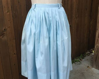 1950s knee length skirt with lovely knife pleats. 100% cotton. Russ brand - union made! Delicate sky blue color. Metal zipper. Size small.
