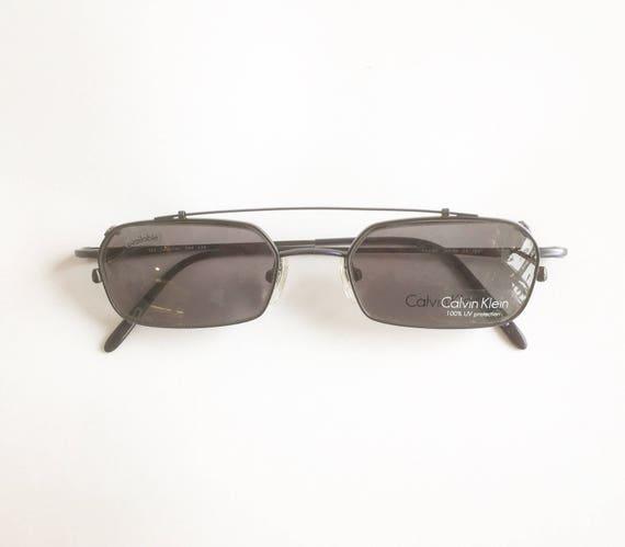 c84a5372cc Vintage 1990 s Calvin Klein Semi Rimless Eyeglasses with