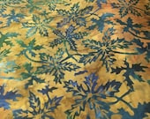 "Batik - Moda Over the Rainbow by Laundry Basket Quilts - 41014 47 - 100% cotton Rich tans and gold with teal/blue leaf - 44"" wide - 1/2 yard"