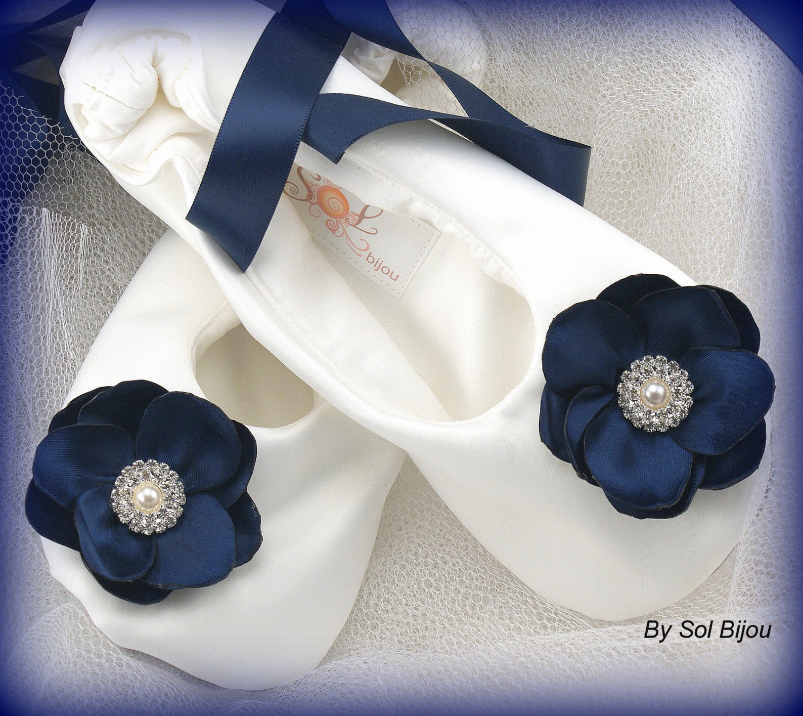 white and black ballet slippers with flowers and ribbon ties wedding shower shoes