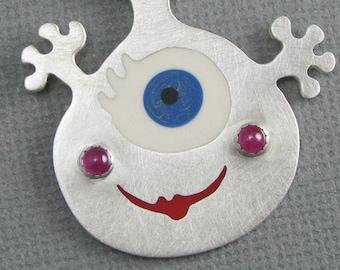 solid sterling silver cute monster pendant. silver pendant with rubies. silver comic pendant. cute monster pendant