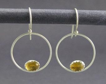solid sterling silver circle earrings. oval citrine sterling silver circle dangle earrings. artisan handmade circle hanging earrings.